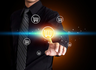 Business man pressing shopping cart icon