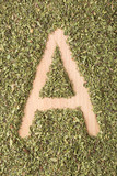 Letter A written with oregano