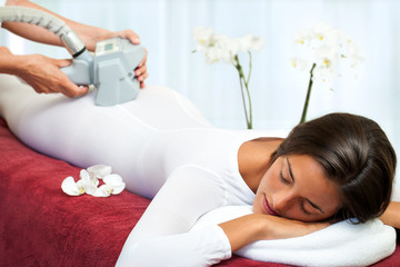 Woman having anti cellulite vibro massage.