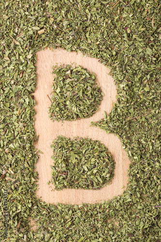 Letter B written with oregano