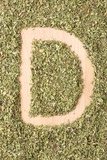 Letter D written with oregano