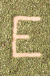 Letter E written with oregano