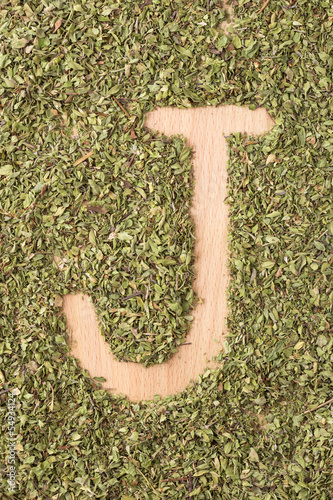 Letter J written with oregano