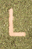 Letter L written with oregano