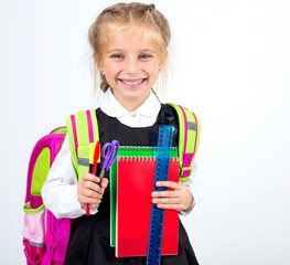 little cute girl with a stationery