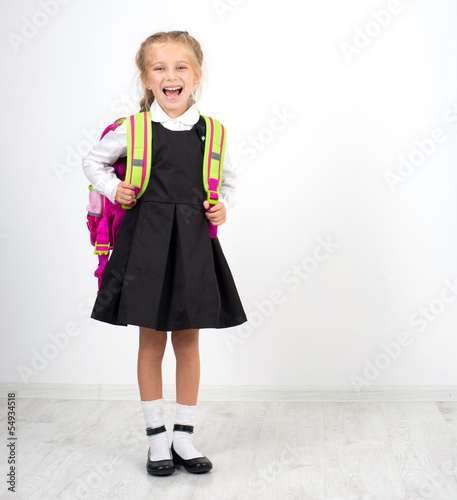 little cute girl with a backpack