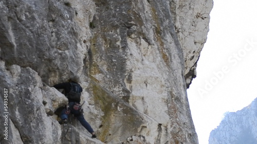 Rock climber searching for handhold