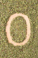 Letter O written with oregano
