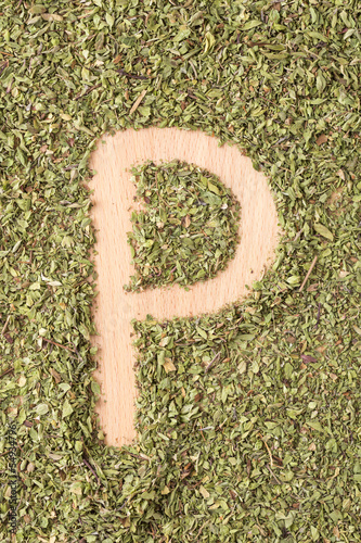 Letter P written with oregano
