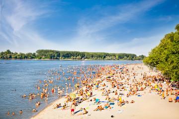 People on the public beach Oficirac on Danube river, Novi Sad, S