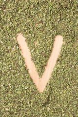 Letter V written with oregano