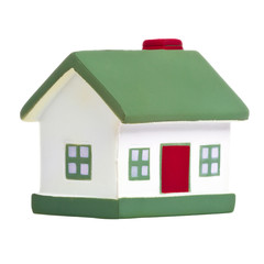 Toy house with green roof isolated on white background