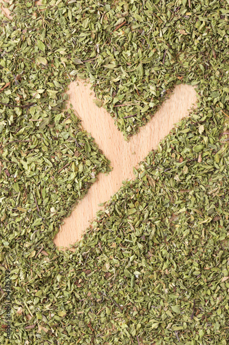 Letter Y written with oregano
