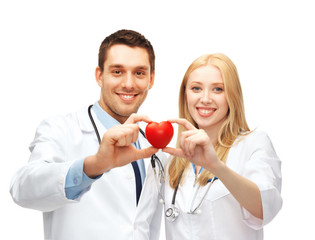 doctors cardiologists with heart