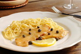 Chicken piccata milanese with pasta