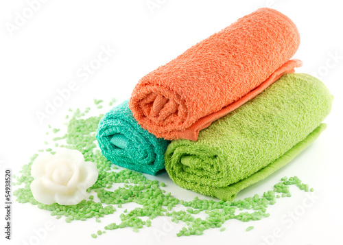 Colorful towels  and soap isolated on white