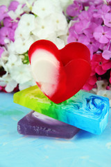 Pieces of handmade soap, on bright background