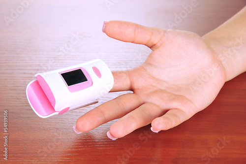 Pulse oximeter used to measure pulse rate and oxygen levels,