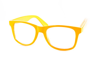 yellow  glasses on white background.