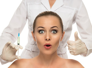 Beautiful woman face,beautician hands with syringe