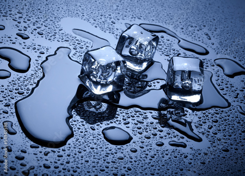 Ice cubes over dark background