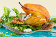 Salad with caramelised pears,walnuts and cheese, on blue plate