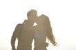 Silhouette of a couple kissing on sunset