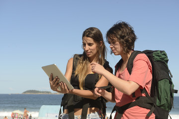 Backpacker using tablet as map