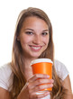 Young girl is happy about her hot coffee