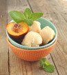 Peach ice cream in bowl