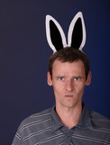 Angry man with rabbit ears