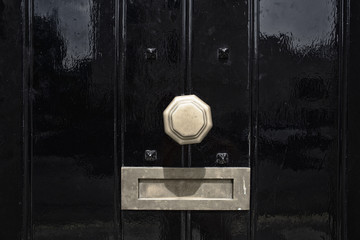 black door with mail slot