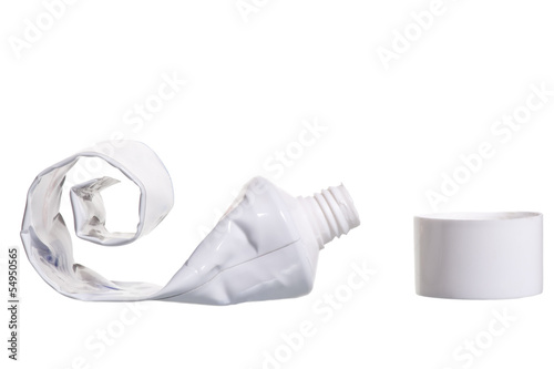 empty cosmetic tube with the lid open on a white background