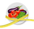 Diet meal. Vegetables in a plate with measuring tape. Concept of