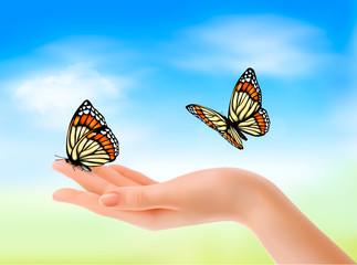Hand holding a butterflies against a blue sky. Vector illustrati