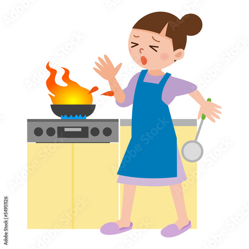 料理中に火傷をする女性