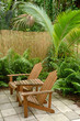 Adirondack chairs and tropical location in the summertime on pat