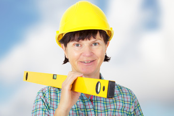 Construction worker with level