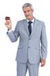 Handsome businessman showing credit card