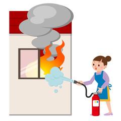 消化器で火を消す主婦
