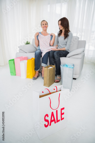 Women with purchases and shopping bag on foreground