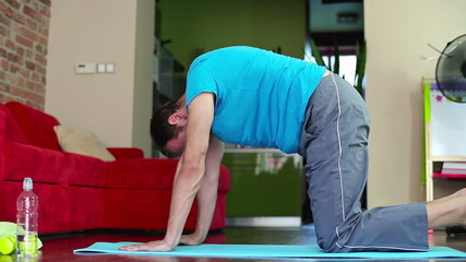 Young man exercising in home