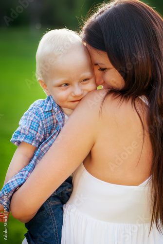 Young Mother and her little son, filled with tenderness