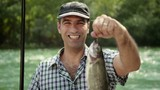 1of8 Man with rod fishing trout on river, portrait
