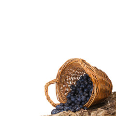 blueberries in wooden basket isolated over white