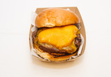 Fast Food Cheeseburger in Cardboard Container