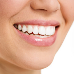 Beautiful smile of young female with white teeth, isolated