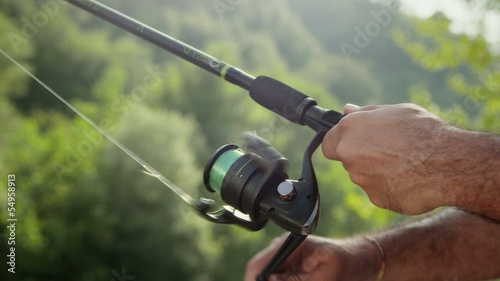 4of8 Man with rod fishing trout on river in Italy
