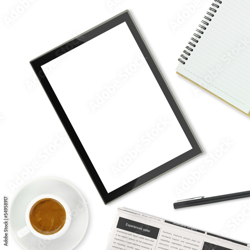 Tablet computer, coffee cup and other office supplies
