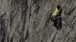 rock climber climbs difficult route